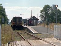 A single car north (or east) bound train calls at Llangadog. Seen from the level crossing.<br><br>[Ewan Crawford&nbsp;//2002]