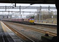 DB 66037 approaches with Longannet - Hunterston High Level empties.<br><br>[Bill Roberton&nbsp;18/03/2016]