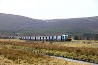 68018 Vigilant has been hauling the Mossend-Inverness container train for most of this week. Pictured north of Moy.<br><br>[John Gray&nbsp;25/03/2016]
