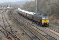 With the lifting of the West Coast Railways suspension a full programme of trains has recommenced, including a <I>Statesman Rail</I> tour from Euston to Fort William on 2nd April 2016. The return leg on 4th April is seen leaving the Up Loop at Carnforth behind 57316. Out of sight behind the Pullman stock is stablemate 57601. <br><br>[Mark Bartlett&nbsp;04/04/2016]