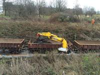 Road rail excavator working on diggings for new trackside drainage. OHLE mast surveyor setting out on the embankment behind.<br><br>[Martin MacGuire&nbsp;02/04/2016]