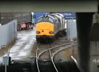 A container train unloading at WHM Grangemouth on 15 January 2005. At the head of the train are DRS class 37 locomotives 37218 (nearest) and 37602. View is south west below the M9 Motorway overbridge.<br><br>[John Furnevel&nbsp;15/01/2005]