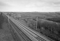 View east from the A70 road bridge of the WCML.  Beyond, the ground is being prepared for Ravenstruther coal loading terminal.  By 2016 it would be closed and demolished.  <br><br>[Bill Roberton&nbsp;//1988]