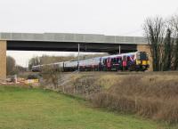 Trans-Pennine 350401 and 350403 form a Manchester Airport to Glasgow service seen passing under the new Heysham Link Road bridge at Morecambe South Junction on 1st April 2016. This was the day that First Group took sole responsibility for the TPE franchise having previously been in partnership with Keolis.  <br><br>[Mark Bartlett&nbsp;01/04/2016]