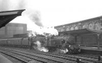 Ivatt class 2MT 41264 of Upperby shed with Edge Hill Black 5 45307 standing with a train at Carlisle platform 4 on Saturday 25 September 1965. Details of the particular working are not known.<br><br>[K A Gray&nbsp;25/09/1965]