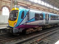 Parked for display, a class 185 unit at Manchester Piccadilly with the new TransPennine livery on the launch day of the new franchise.<br><br>[Hugh McLellan&nbsp;01/04/2016]