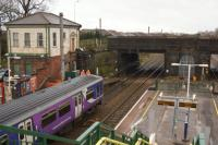 Looking north from the top of the steps of the new footbridge at Leyland to where the old bridge used to be on 09 March 2016. The old station booking office is now sealed up and a question hangs over it's future. The view could change again in the near future. Compare with a view from just over 6 years earlier [See Image 27212].<br><br>[John McIntyre&nbsp;09/03/2016]