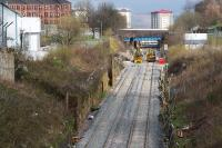 View up the Incline from Pinkston Road. Rail mounted cement mixers and Road/Rail Vehicles can be seen parked at the Keppochhill Drive/Fountainwells access point. Above them can be seen the blue painted Fountainwells overbridge which is scheduled for demolition soon.<br> <br><br>[Colin McDonald&nbsp;15/04/2016]