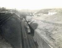 Scene on Cowlairs Incline on 11 May 1955, with A4 Pacific 60031 <I>Golden Plover</I> descending with a train towards Queen Street. (The more distant of the two bridges in the background carried a connection from the Port Dundas Branch to Tennant's Works, off to the right.)<br><br>[G H Robin collection by courtesy of the Mitchell Library, Glasgow&nbsp;11/05/1955]