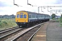 "A Class 101 DMU passes through Wivenhoe station on 23rd August 1981. The train was a ""Seaside Special"" that had visited Clacton and Walton (where it had been stabled for the day). Chartered by the Fakenham and Dereham Railway Society, it is seen here returning home to stations between Wymondham and Ryburgh in Norfolk. [Ref query 4089]<br><br>[Mark Dufton&nbsp;23/08/1981]"