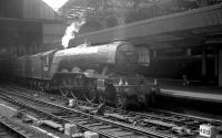 A boat train stands at Newcastle Central on 23 June 1962. A3 60083 <I>Sir Hugo</I> has recently arrived with the 9.40am Kings Cross - Tyne Commission Quay. The Pacific is preparing to hand over to a V1/V3 2-6-2T for the final short leg of the journey. [See image 35716]<br><br>[K A Gray&nbsp;23/06/1962]