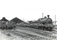 A lineup of ex-Caledonian 3F 0-6-0s on shed at Ayr in the summer of 1959. The locomotives are 57596 (nearest), 57644, 57611, 57580 and 57633.      <br><br>[G H Robin collection by courtesy of the Mitchell Library, Glasgow&nbsp;04/07/1959]
