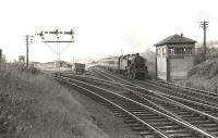 A Sunday Largs - Glasgow service about to run through Fairlie Pier Junction on 5 July 1959. The train is hauled by Ardrossan shed's Fairburn 2-6-4T no 42124. <br><br>[G H Robin collection by courtesy of the Mitchell Library, Glasgow&nbsp;05/07/1959]
