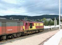An Inverness bound parcels train held at the north end of Aviemore station under a heavy sky on 25 September 2004. EWS 67024 is the locomotive in charge. <br><br>[John Furnevel&nbsp;25/09/2004]