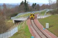 ScotRail 158749 crossing the A7 on Gore Glen Bridge southbound on 10 April 2016 with the 1024 Edinburgh - Tweedbank. The train is just under half a mile from its next stop at Gorebridge.  <br><br>[John Furnevel&nbsp;10/04/2016]