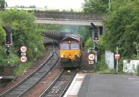 EWS 66212 with Longannet - Hunterston coal empties coming off the Dunfermline line at Inverkeithing Central Junction on an overcast morning in June 2006. View north from Inverkeithing station.<br><br>[John Furnevel&nbsp;19/06/2006]
