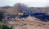 66100 hauls a train of hot rolled coil up Stormy Bank heading for Llanwern. Behind the was Water Street Junction, controlled by Pyle West signal box, which led to the reception sidings for Margam Marshalling Yard, which were off to the left.<br><br>[Alastair McLellan&nbsp;07/01/2010]