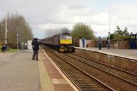 A railtour returning to Bridlington heads west at Wigton on 16 April 2016. Expectation of a steam locomotive heading this part of the tour had resulted in quite a few locals turning up but a Class 47 deputised. With the plume of exhaust it perhaps was trying to represent Galatea which had been booked to pass.<br><br>[John McIntyre&nbsp;16/04/2016]