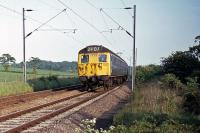 A Class 308/1 EMU is recorded between Wivenhoe and Hythe while working a Clacton/Walton to Colchester local service on 17th May 1976. These 1961 vintage units were replaced on this line by Class 313 EMUs in the early 1980s, but made a comeback after refurbishment and soldiered on for a few more years.<br><br>[Mark Dufton&nbsp;17/05/1976]