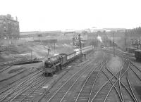 Looking north over the approaches Buchanan Street at Dobbies Loan on Saturday 16 April 1955. Black 5 45156 <I>Ayrshire Yeomanry</I> is about to enter the station with a train from Oban.<br><br>[G H Robin collection by courtesy of the Mitchell Library, Glasgow&nbsp;16/04/1955]