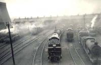 General view of the north end of Eastfield shed on 29 April 1950 with a smokescreen hanging over the busy yard. Photograph taken from the window of a passing train on the Balornock Junction to Possil line. <br><br>[G H Robin collection by courtesy of the Mitchell Library, Glasgow&nbsp;29/04/1950]