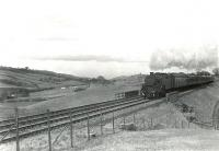 In the hills above Shilford on a spring afternoon in late March 1962. The train is the 5.12pm Glasgow Central - Uplawmoor and the locomotive is Fairburn 2-6-4 tank 42056.  <br><br>[G H Robin collection by courtesy of the Mitchell Library, Glasgow&nbsp;30/03/1962]