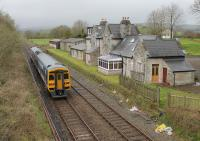 A Leeds to Morecambe service hurries past the closed station at Arkholme, now a private residence, on 18th April 2016. [See image 19610] Hopefully the regular <I>Little North Western line</I> passengers were appreciating the comfort of 158903 as services on these old jointed tracks are very often handled by Pacers.   <br><br>[Mark Bartlett&nbsp;18/04/2016]