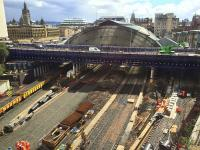 View over the Queen Street works as sleepers are being laid for the realigned platform 4 and 5 roads. The crane on Cathedral Street Bridge is lifting down building materials for the reconstruction of the north end of platforms 1 and 2. Only platform 7 where the ballast train is stabled now has the track dating from before the start of the station works.