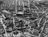 An aerial image of Accrington station looking west, probably taken in the 1950s. It clearly shows the triangular layout that was in place until 1966 when the line to Stubbins and Bury closed. The south to west chord had no platforms but passed by the goods shed. The surviving Burnley to Blackburn line runs from the bottom right hand corner through the station to the middle right of the picture - everything else has gone. <I>Photographer unknown</I>.<br><br>[Mark Bartlett Collection&nbsp;//]
