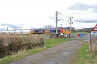 GBRf 66737 passes over Geilston Level Crossing, just west of Cardross.<br><br>[Ewan Crawford&nbsp;08/04/2016]