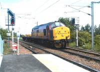 EWS 37427 with a lightweight load southbound past Newcraighall station on 10 June 2002 heading for Millerhill yard. The new single platform station had been officially opened a week earlier.<br><br>[John Furnevel&nbsp;10/06/2002]