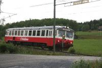 This Fiat-built Y1 diesel railcar is normally only seen on the Inlandsbanan i.e. the non-electrifed North-South route between Mora and Gällivare. That route shares a short section with Mittbanan east of Östersund. These units have also been seen west of Östersund as here at Svensta Level Crossing west of Järpen. The crossing is open. It has an overhead height limit indicator on wooden poles and a mirror for visual confirmation that the track is clear seen here obscuring part of the railbus front window. A light is provided to warn for the approach of oncoming trains [see image 57536] and [see image 57524].<br><br>[Charlie Niven&nbsp;31/07/2014]