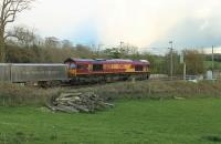 DB 66120, in EWS livery, takes the regular Hardendale (Shap) to Margam freight south through Bay Horse on the evening of 27th April 2016. The train is scheduled to leave Hardendale at 1826hrs and run via Shrewsbury and Hereford to arrive in Margam at 0439hrs.<br><br>[Mark Bartlett 27/04/2016]