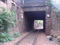 Detailed close up of Up line passing under OB 17 Craigmillar Park/Mayfield Gardens and adjacent steps down onto the platform at the former Newington Station.<br><br>[Charlie Niven&nbsp;25/04/2002]