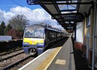 Recent timetable changes have beefed up Dumbarton's service, with trains extended from Dalmuir and using the normally quiet Platform 3. 320 313 waits with a Cumbernauld service on 30/04/2016.<br><br>[David Panton&nbsp;30/04/2016]