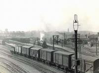 General view over Buchanan Street station on a grey afternoon in April 1954. In the centre of the picture Black 5 no 44980 is about to depart with the 1.45pm to Inverness.