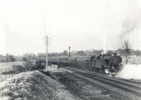 Fairburn 2-6-4T 42056 at the site of Lugton East Junction on 21 March 1962 with the empty stock of a Glasgow Central - Uplawmoor train. Photographed shortly before the withdrawal of passenger services between Neilston and Uplawmoor.  <br><br>[G H Robin collection by courtesy of the Mitchell Library, Glasgow&nbsp;21/03/1962]