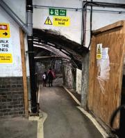 This rather unusual exit from the platform underpass at Temple Meads was used to guide enthusiasts from the station to the waiting shuttle buses for the St Philip's Marsh open day. For the usual standard of passage see image [[42033]] [Ref query 44498].<br><br>[Ken Strachan 02/05/2016]