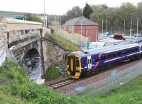 A Tweedbank - Edinburgh train about to restart from the platform at Newtongrange on 1 May 2016 before passing below the bridge carrying the A7.<br><br>[John Furnevel&nbsp;01/05/2016]