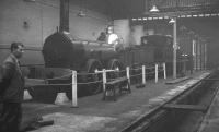 Furness Railway 0-4-0 No 3, built by Bury, Curtis and Kennedy of Liverpool in 1846, on display inside Horwich Works in 1960. Nicknamed <I>'Old Coppernob'</I> due to the copper cladding around its dome shaped firebox, it was latterly employed on local work around Barrow, before withdrawal in 1900. The locomotive shows some signs of shrapnel damage from German bombs, received while on display at Barrow station early in WWII. It was later moved to Horwich, where it remained until 1963, then to Clapham Railway Museum until 1975 and finally to the NRM in York, where it now forms part of the national collection. <br><br>[K A Gray&nbsp;//1960]