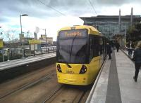 Metrolink trams to and from Eccles usually reverse at Media City. The unusual proboscis above the station notice board on the left in this April 2016 shot is part of the Imperial War Museum (North).<br><br>[Ken Strachan&nbsp;16/04/2016]