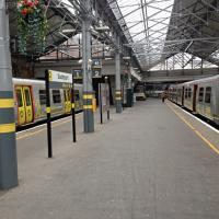 Two gray livery Merseyrail trains at Southport platforms 1 and 2.<br><br>[Veronica Clibbery&nbsp;/04/2016]