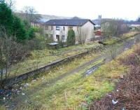 Scene at Caldercruix in December 2008 looking west from Main Street road bridge over the station site. Caldercruix had closed to passenger traffic in 1956, with the line closing completely in 1982. Preliminary work on the new station was due to commence a short time after this photograph was taken, with some of the housing on the left having already been vacated pending demolition. [See image 33076]<br><br>[John Furnevel&nbsp;26/12/2008]