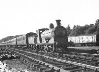 Scene in the sidings at Balloch on 9 July 1957, featuring Dawsholm shed's ex-Caledonian 3F 0-6-0 57554 with a train of empty stock.  <br><br>[G H Robin collection by courtesy of the Mitchell Library, Glasgow&nbsp;09/07/1957]