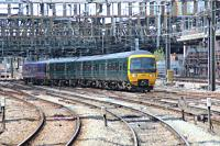 Class 166 DMU's approaching Paddington with the lead set in the new GWR colours.<br><br>[Alastair McLellan&nbsp;15/05/2016]