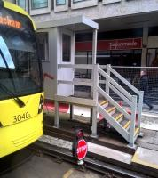 One up on swinging barriers [see image 48313]. All trams entering or leaving the Piccadilly Gardens area currently have to stop (see the rail level stop board) and receive authorization to proceed from a person in a cabin.<br><br>[Ken Strachan&nbsp;16/04/2016]
