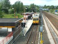 A Tyne & Wear Metro service destined for South Shields arrives at Pelaw station in the summer of 2004.<br><br>[John Furnevel&nbsp;10/07/2004]