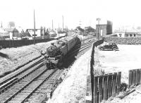 Fairburn tank 42196 passing Hawkhill Junction with a Glasgow - Ayr train on a sunny July day in 1959. Ayr locomotive shed stands in the background.<br><br>[G H Robin collection by courtesy of the Mitchell Library, Glasgow&nbsp;04/07/1959]