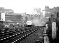 A westbound commuter service restarting from Haymarket in September 1979. The DMU is about to pass Haymarket coal depot after leaving a blue haze over Haymarket East Junction.<br><br>[John Furnevel&nbsp;17/09/1979]