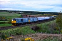 For only the second time, two Class 73's have hauled the Caledonian Sleeper to Inverness. 73966 and 73967 are pictured leaving Culloden Viaduct on the return working to Edinburgh on 21 May 2016. There the sleeper coaches will those from Fort William and Aberdeen before going on to London Euston.<br><br>[John Gray&nbsp;21/05/2016]